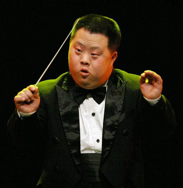 CHINESE DOWN SYNDROME PERFORMER HU YIZHOU CONDUCTS AT A CONCERT IN SEOUL.